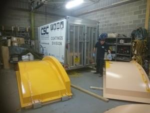 Application of marine grade coating top-coat to tank lids