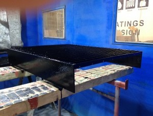 Coating of gratings with a marine grade coating system