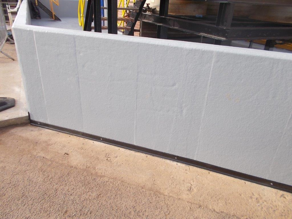 Bund wall with waterproof coating system installed